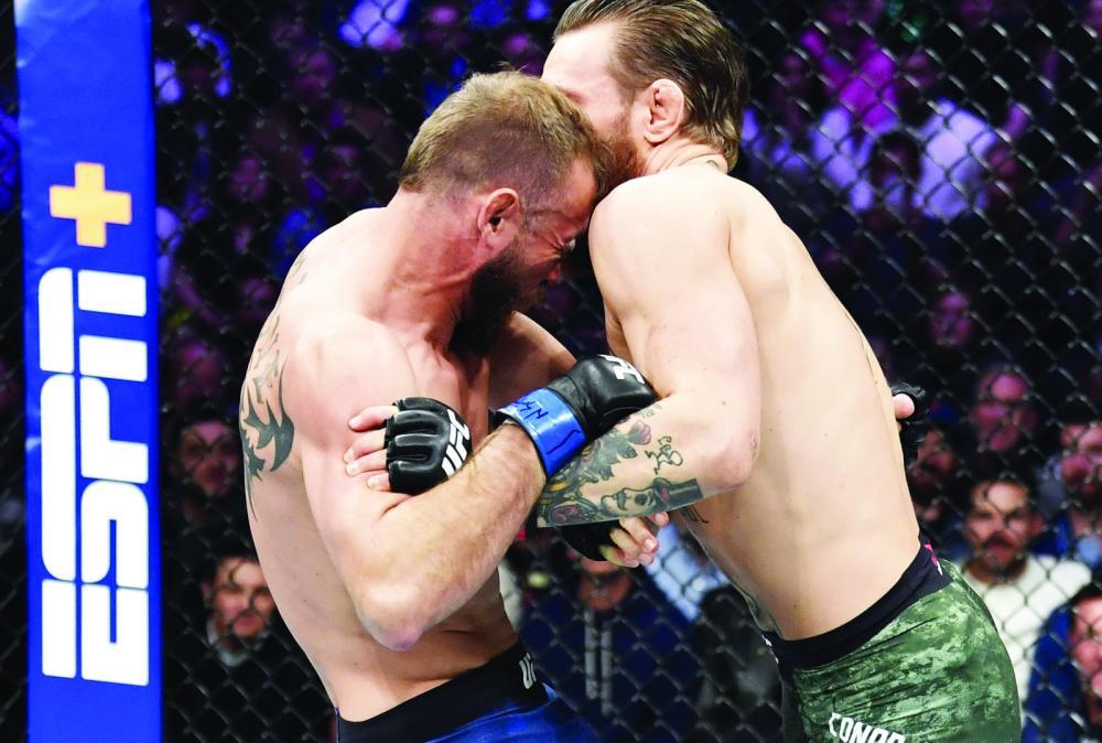 """Americano foi surpreendido pelos golpes pouco comuns aplicados por """"Notorious"""", que o nocauteou em apenas 40 segundos na luta principal do UFC 246, no sábado, em Las Vegas - Foto: Getty Images"""